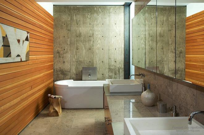 Những lát gỗ cũng có thể được dùng thay gạch tráng men để ốp bao quanh nhà tắm.