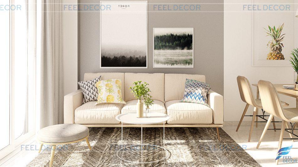 Phòng khách căn hộ 76m2 luôn mang cảm giác thoáng rộng, vì chọn nội thất tone màu sáng nhẹ nhàng. Thiết kế tuy đơn giản nhưng lại mang điểm nhấn bởi tường – thảm màu xám tương phản hiện đại.