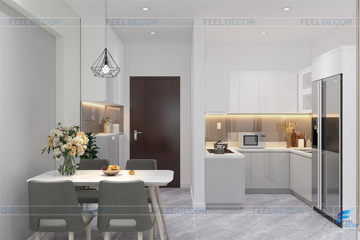 Bàn ăn được thiết kế sát tường, ngăn cách không gian nhà bếp và phòng khách.